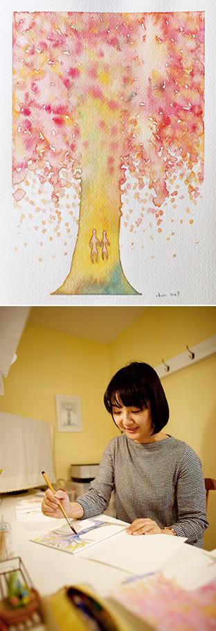 上:大きな樹木に小さな2人の人間の姿が。もっとも多いモチーフである/下:自然体で制作に没頭する。「心が解放される楽しいひと時です」