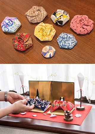 上:手作りの布ブローチ。亡父のネクタイなどもリユースして使い、故人を偲ぶ品にしている/下:去年(2018)2月、東京第二教区の講習会が開かれた時、谷口雅宣・生長の家総裁、谷口純子・白鳩会総裁の控室に飾られた、横山さんお手製の和紙の雛人形